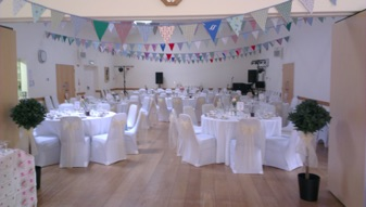 Village hall laid out for a wedding reception